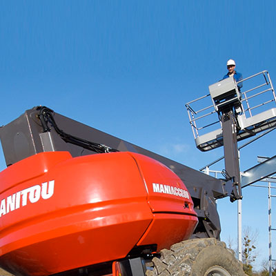 Picture showing a Manitou Access Platform being operated on a building site.