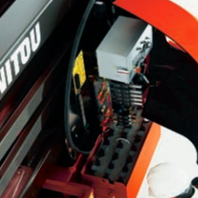 Picture showing an operator performing maintenance on a Manitou Access Lift