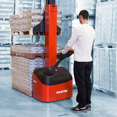Picture of a Manitou Stacker being operated in a warehouse