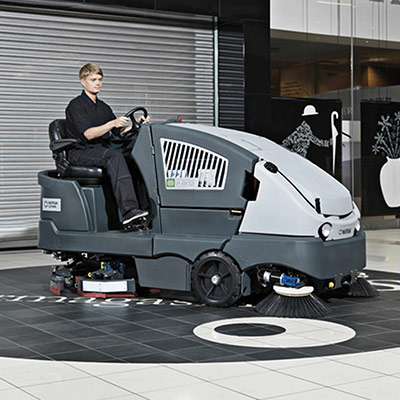 Picture showing a Nilfisk Sweeper being operated in a mall
