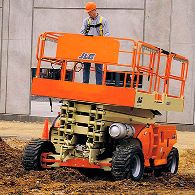 Image shoing a JLG Scissor Lift being operated on a building site